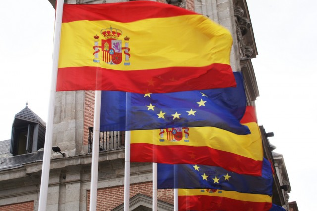 Flags of Spain (red and yellow) and Europe (blue with 12 stars) in the Plaza de la Villa (Town Square) de Madrid (Spain), to commemorate the Spanish presidency of the European Union in the first half of 2010.