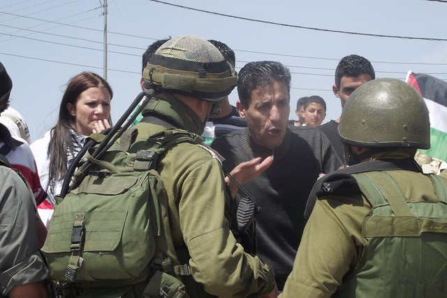Palestinians clash with Israeli troops. Image credit: CC by Palestinian Solidarity/Flickr.