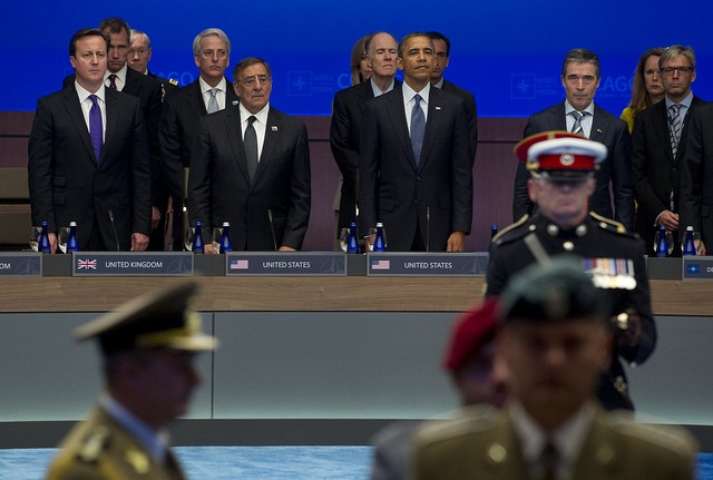 David Cameron, Secretary of Defense Leon E. Panetta, President Barack Obama and NATO Secretary General Anders Fogh Rasmussen observe a NATO color guard prior to a moment of silence honoring those service members killed at wounded in Afghanistan at the NATO Summit in Chicago